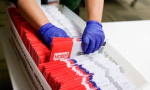 Election workers sort vote-by-mail ballots for the presidential primary at in Renton, Washington, on Tuesday. Many who voted early will have cast their ballots for candidates no longer in the race.