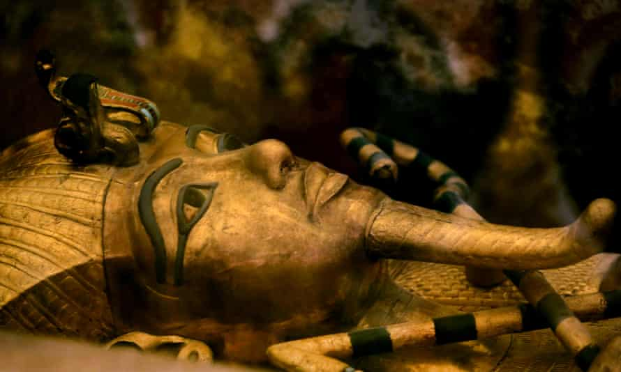 King Tutankhamun's golden sarcophagus displayed in a glass case in his tomb, at the Valley of the Kings in Luxor.