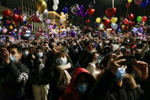 Crowds gather to celebrate the arrival of the new year in Wuhan, China