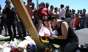 Flowers and soft toys are left near the site where a truck rammed into a crowd of revellers celebrating Bastille Day, killing at least 84 people.
