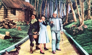 Dorothy, the scarecrow and the tin man on the yellow brick road in the Wizard of Oz.