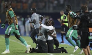 Aliou Cissé celebrates Senegal's dramatic semi-final victory against Tunisia in Cairo.