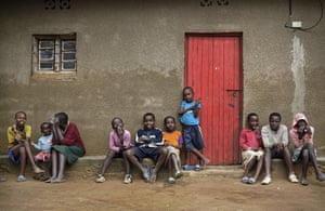 The children of genocide survivors and perpetrators play together in a 'reconciliation village' near Nyamata.