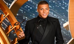 Paris Saint-Germain's Kylian Mbappé collecting the Ligue 1 player of the year award on Sunday.