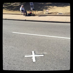'X' marks the spot where the third and final shot fired by Lee Harvey Oswald struck John F Kennedy in the back of the head, killing him instantly. Elm Street, Dallas
