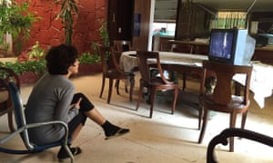 Ailer González, a member of the Forum for Rights and Freedom, watches President Obama's speech in Havana.