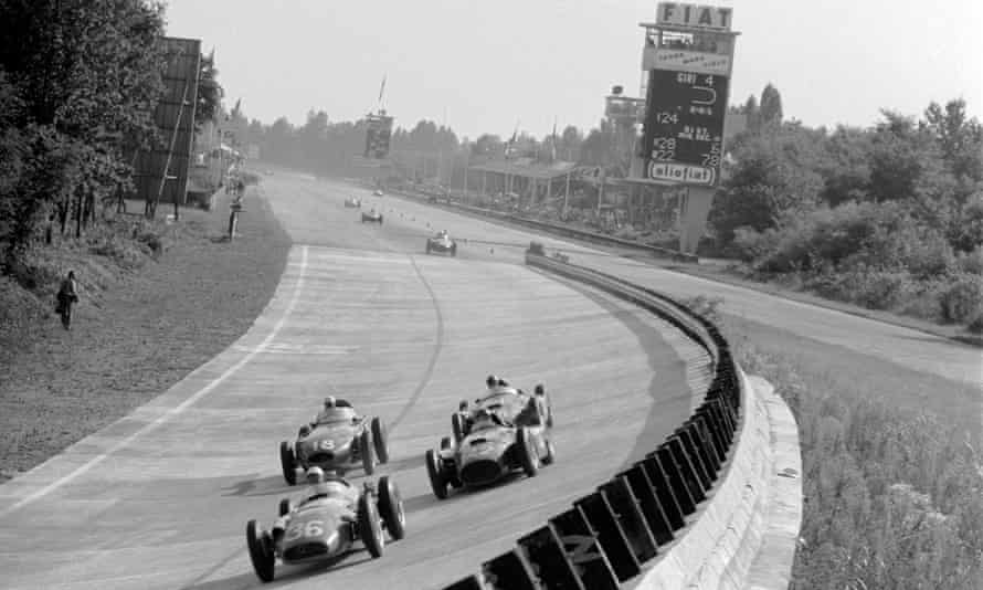 Stirling Moss leads Juan Manuel Fangio and Peter Collins in the finale of the 1956 season in Monza; Collins handed his car over to Fangio later in the race.
