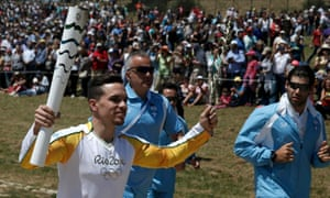 Olympic flame first torch bearer, Greek gymnast Eleftherios Petrounias.