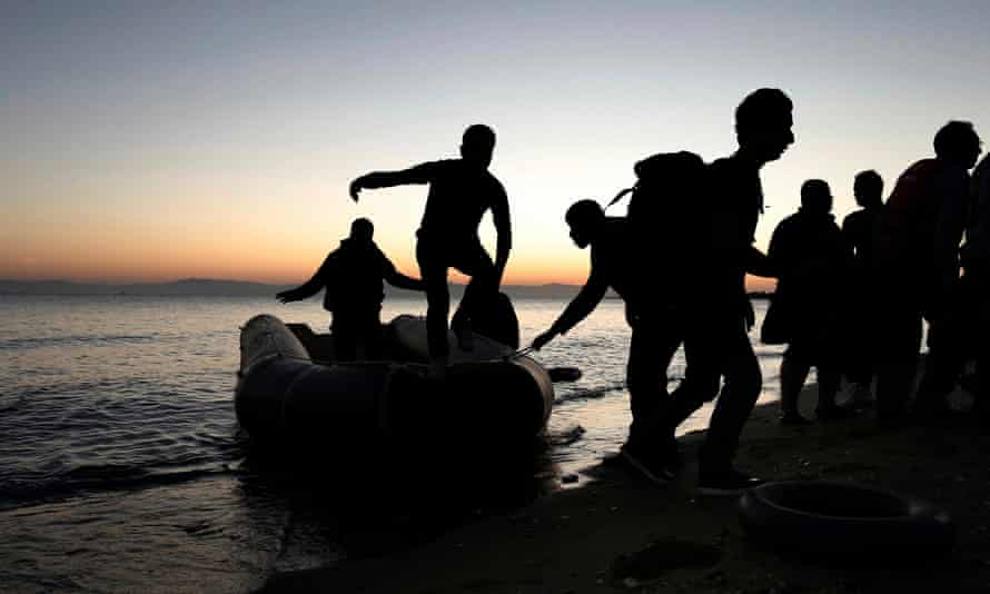 Syrians arrive in a dinghy on Kos island, Greece. at night
