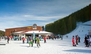 Skiers and snowboarders at Bansko ski resort in Bulgaria