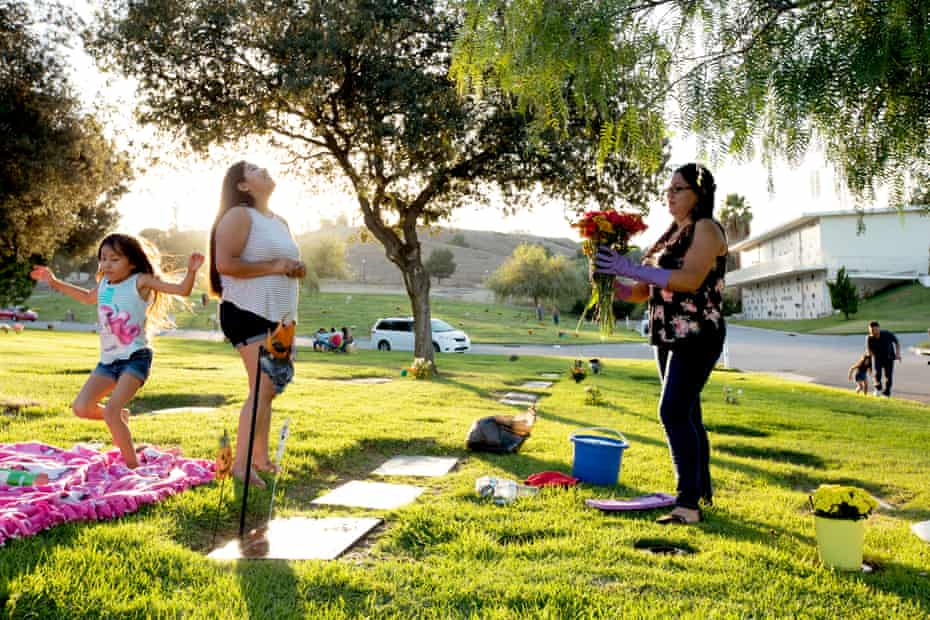Sandy Ramos (on left, looking up) visits her brother's grave in Rowland Heights, 2017