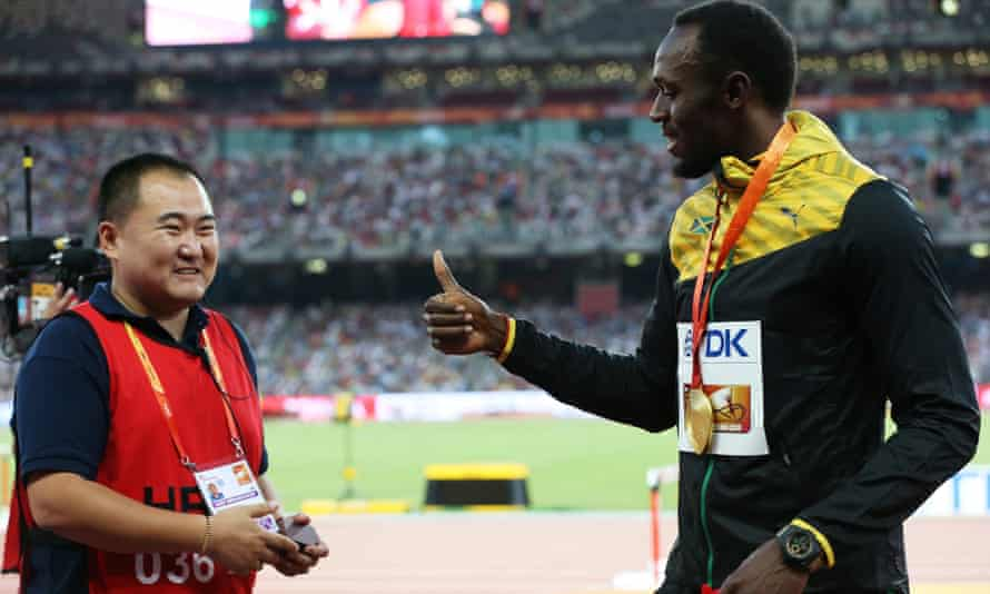 Usain Bolt with Song Tao, the cameraman who knocked him over moments after winning the 200m world title in Beijing.
