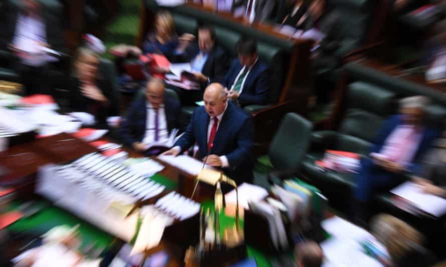 Victorian treasurer Tim Pallas (centre) delivers his budget speech on Thursday.
