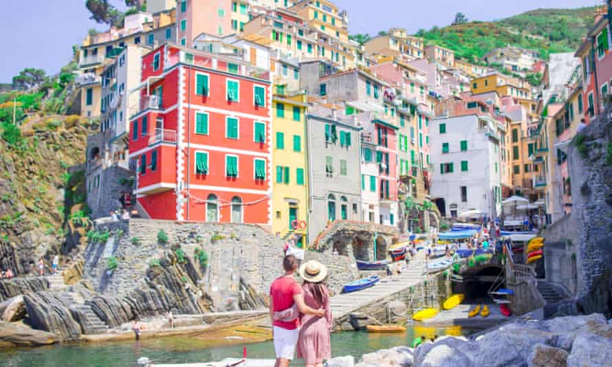 The Cinque Terre villages in Liguria have a ticketing system to cap visitors to 1.5 million a year.