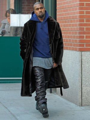 Kanye West takes the streets wearing his leather joggers