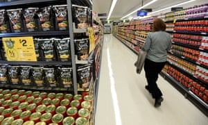 Woman walking through a product aisle in a Woolworths supermarket in Everton Park in Brisbane's northern suburbs.