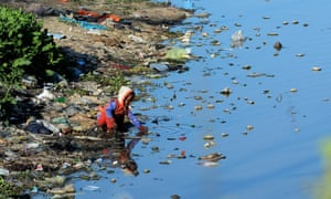 A boy plays in the waters of a polluted canal in Lahore