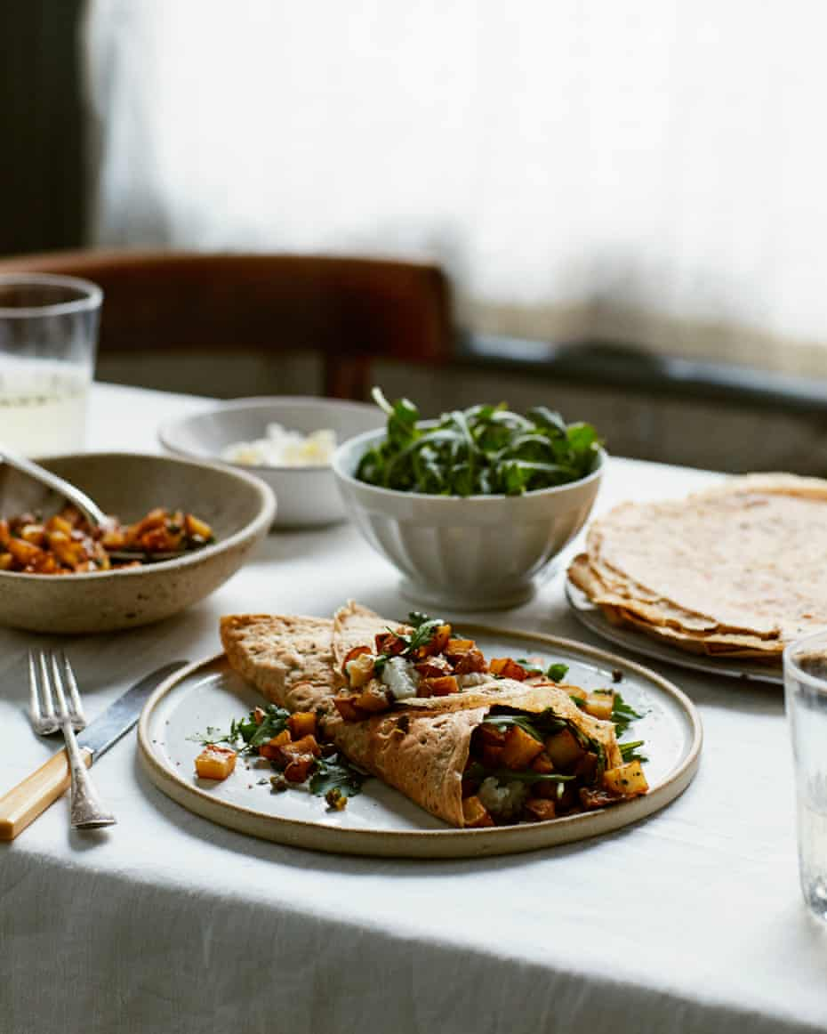 A savoury crepe stuffed with golden potatoes, fried capers and ricotta .