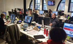Guardian Australia journalists in the Sydney office react as the leap second passes by on July 1, 2015. News editor Mike Ticher (middle right) is pictured showing Alan Evans that his online clock has stopped working three seconds short of the event.