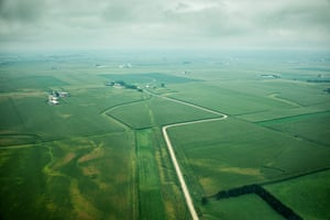An arial view of the Iowan countryside: crop fields stretch out for as far as the eye can see