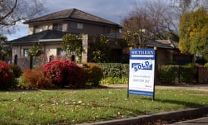 A sale sign is seen in front of a house in Canberra