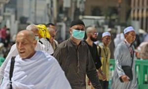 Muslim pilgrims wear masks in Mecca on 27 February.