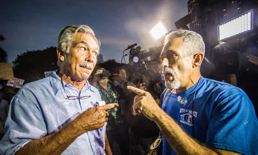 A Trump protester (left) arguing with a Trump supporter who repeatedly slapped his hands in Miami.