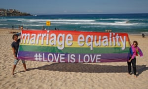 Marriage equality sign on beach.
