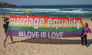 Marriage equality supporters raise the rainbow flag at Bondi beach in August 2015. <br>