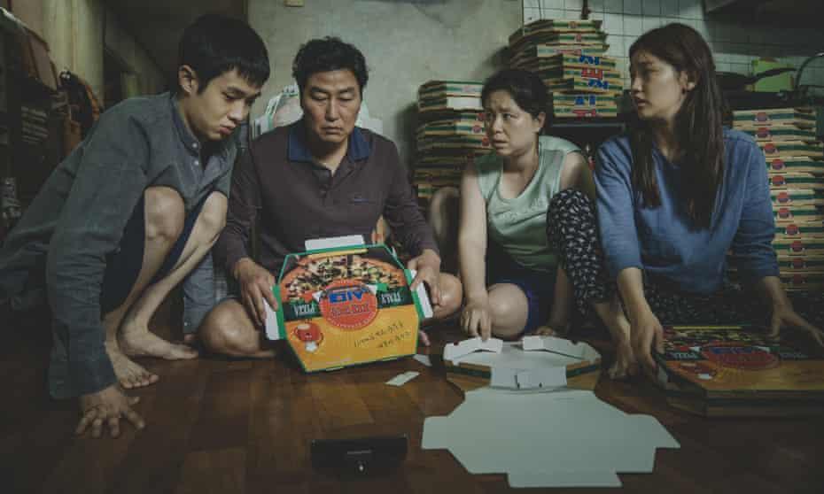 Woo-sik Choi, Kang-ho Song, Hye-jin Jang and So-dam Park in a scene from Parasite.