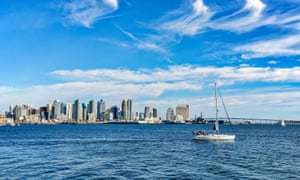 Sailboat gliding by Harbor Bay in San Diego, California