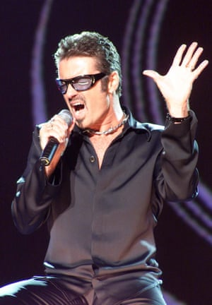 The singer performs at the NetAid charity concert at Wembley Stadium in London in 1999.