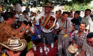 Spectators clap to the rhythm of vallenato as played in the city's streets and plaza rather than its huge sports stadium. Valledupar, Colombia.