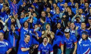 Iceland fans celebrate after their team beat Finland in the World Cup qualifying match.