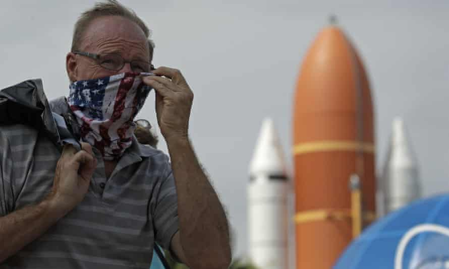 A man adjusts his mask at the Kennedy Space Center Visitor Complex, at Cape Canaveral on Thursday. The center reopened today after closing on 16 March due to the coronavirus pandemic.