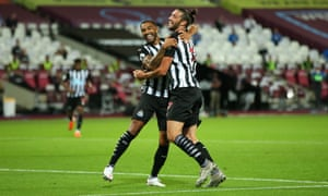 Callum Wilson celebrates with teammate Andy Carroll after scoring Newcastle's opener at West Ham