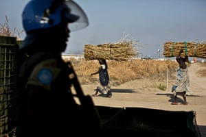 A police officer from Rwanda working under the auspices of Unmiss, the UN mission in South Sudan, stands guard at the entrance of Malakal camp