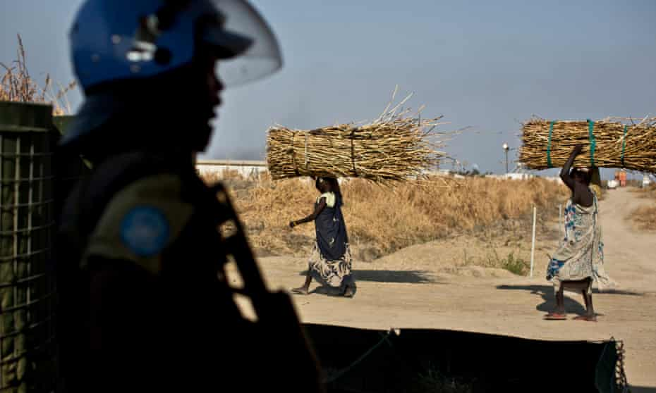 A UN police officer stands guard at the entrance to the Malakal camp in South Sudan