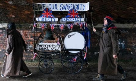 A couple push a Save Our Sovereignty trolley through a tunnel during the first leg of the March to Leave.