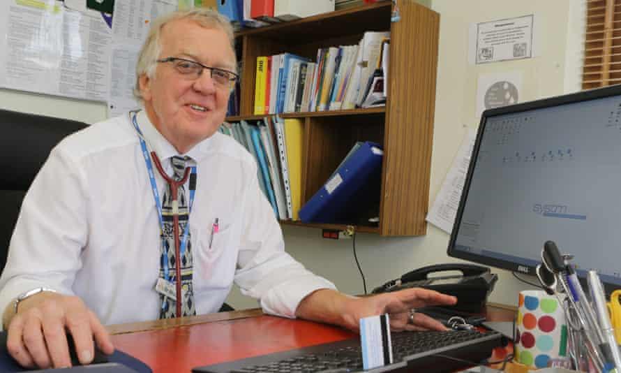 Dr Graham Blockey  at his desk in his surgery
