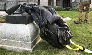 The toppled statue of a Confederate soldier in front of the old Durham County Courthouse in Durham, North Carolina
