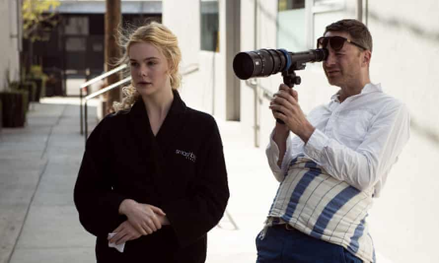 Elle Fanning and Nicolas Winding Refn on set.