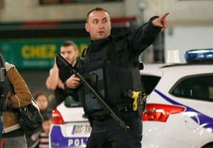 A French policeman points as he evacuates residents during the operation