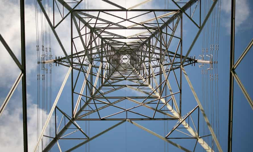 A pylon carries electricty from the Wylfa nuclear power station in Tregele, Anglesey.