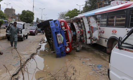 A truck lying overturned on a flood-damaged road in Karachi on Friday.