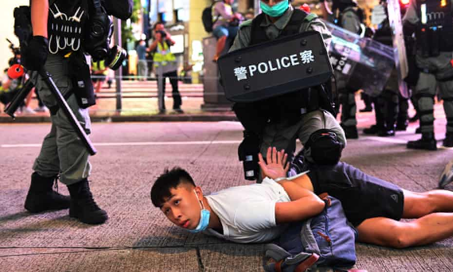 Police officers detain a protesters during a rally against a new national security law on the 23rd anniversary of the handover of Hong Kong from the UK to China