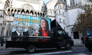 A van with a poster showing Boris Johnson, Jeremy Corbyn and Jo Swinson, with the tagline 'Debate her' outside the Royal Courts of justice in London