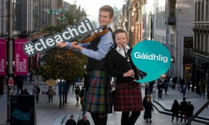 Finlay and Maili MacLennan unveil the Bord na Gaidhlig's new Gaelic identifier at the Mòd Glasgow 2019. Gaelic speakers are being encouraged to use the hashtag #cleachdi or #useit plus the hashtag #gaidhlig online.