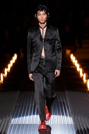 Black suits as evening-wear at the Prada show, Milan.
