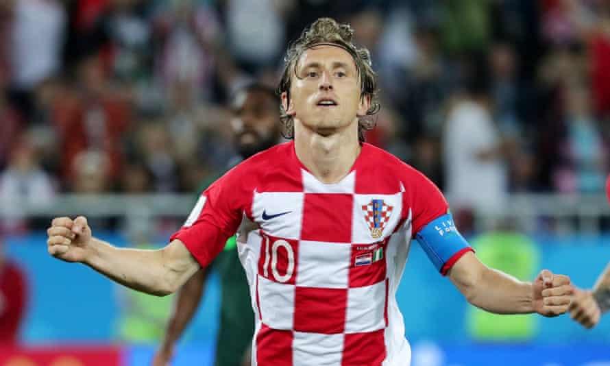 Luka Modric celebrates scoring against Nigeria.